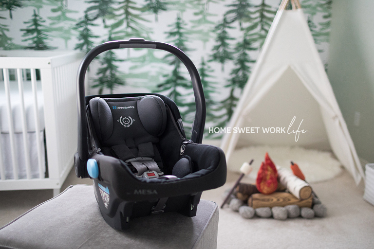 Pacific Northwest outdoor camping baby nursery with play campfire and  UPPAbaby carseat waiting for newborn